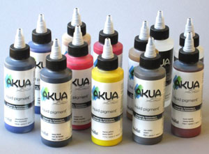 12 bottles of the Akua Liquid Pigment Intro Set